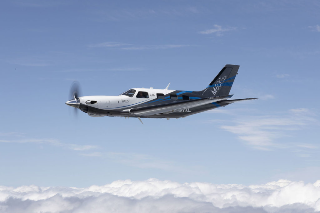 Piper M600/SLS aircraft flying over the clouds