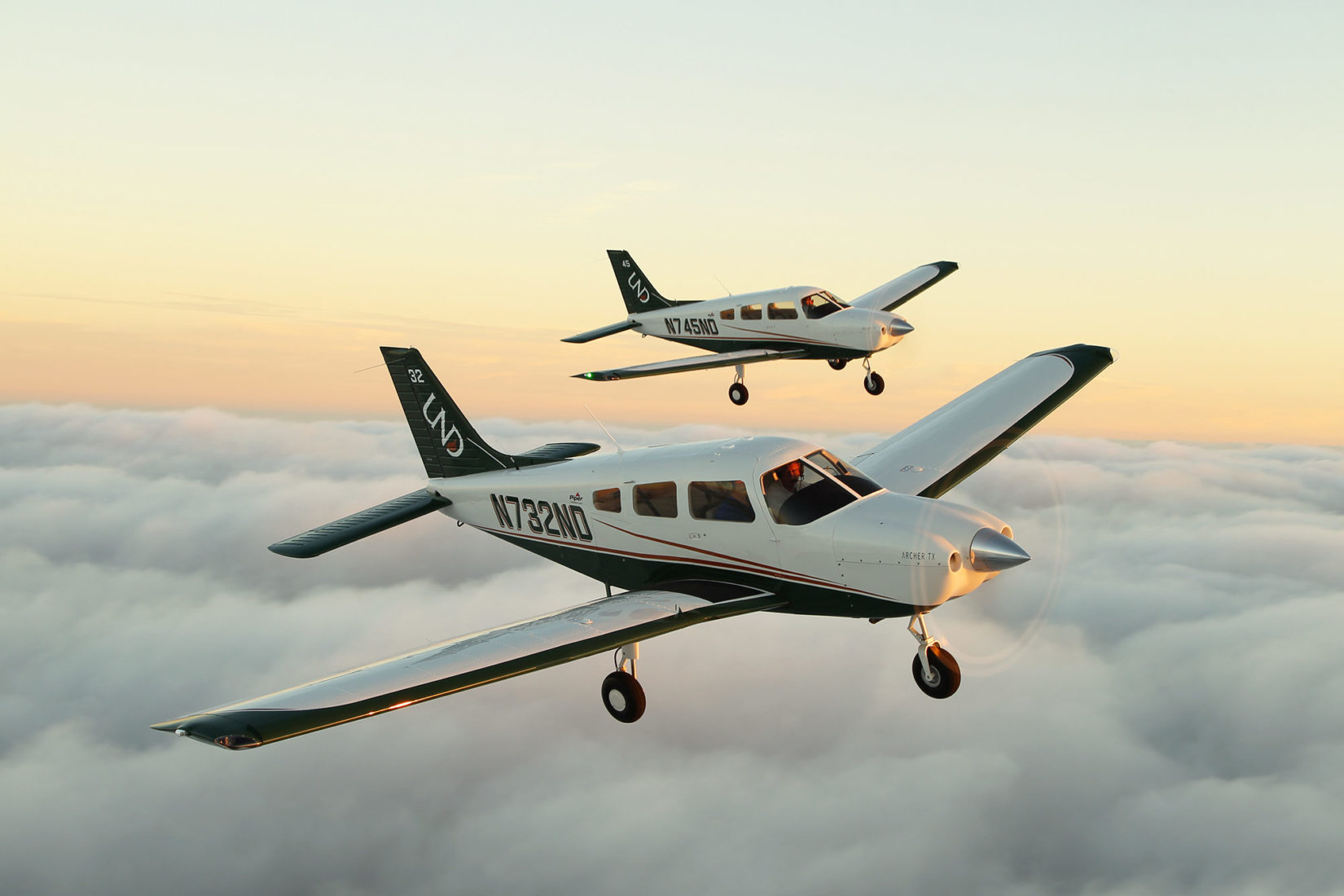 Two aircraft flying, both Archer TX trainer class from Piper Aircraft