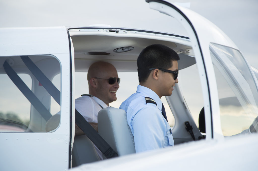 Flight training student and teacher in a cockpit