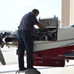 Service provider working on the engine of an aircraft