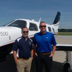 Des Moines Flying Services team in front of a M500