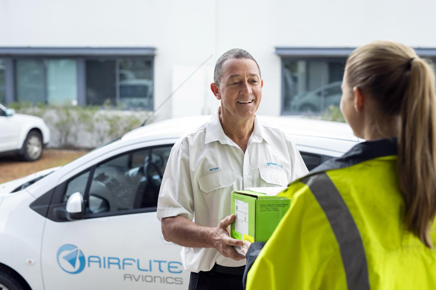 Airflite technician receiving a parts box