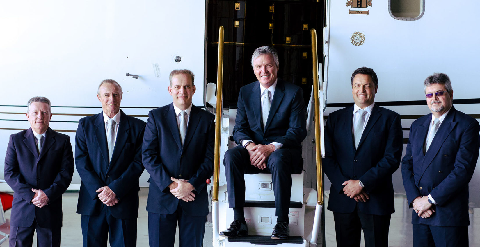NAC executive team in front of an aircraft