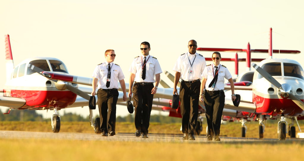 Flight training students walking on the runway