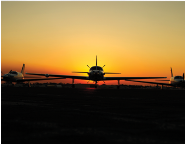 Piper Aircraft M class model with a sunset