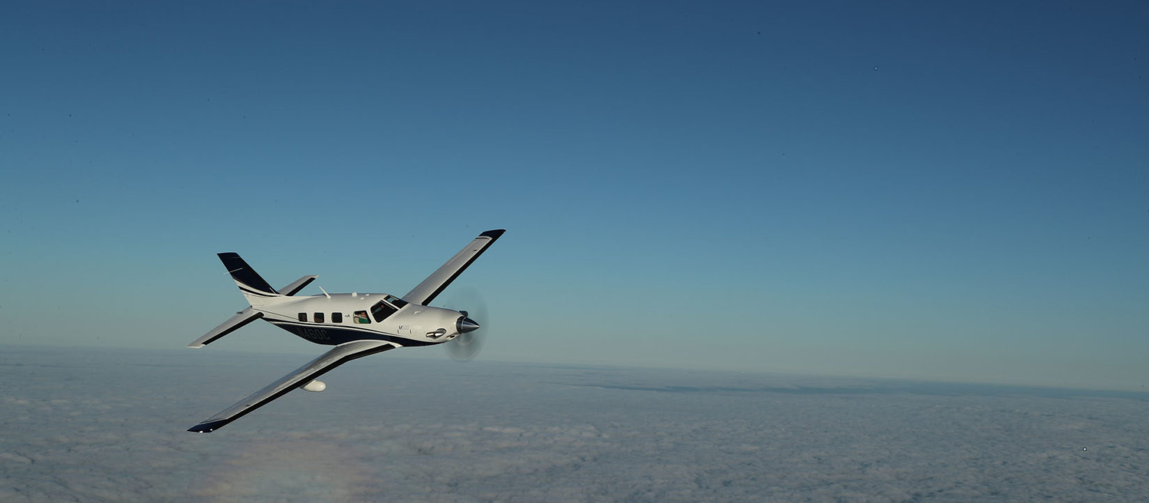 Piper Aircraft fleet flying in the sky