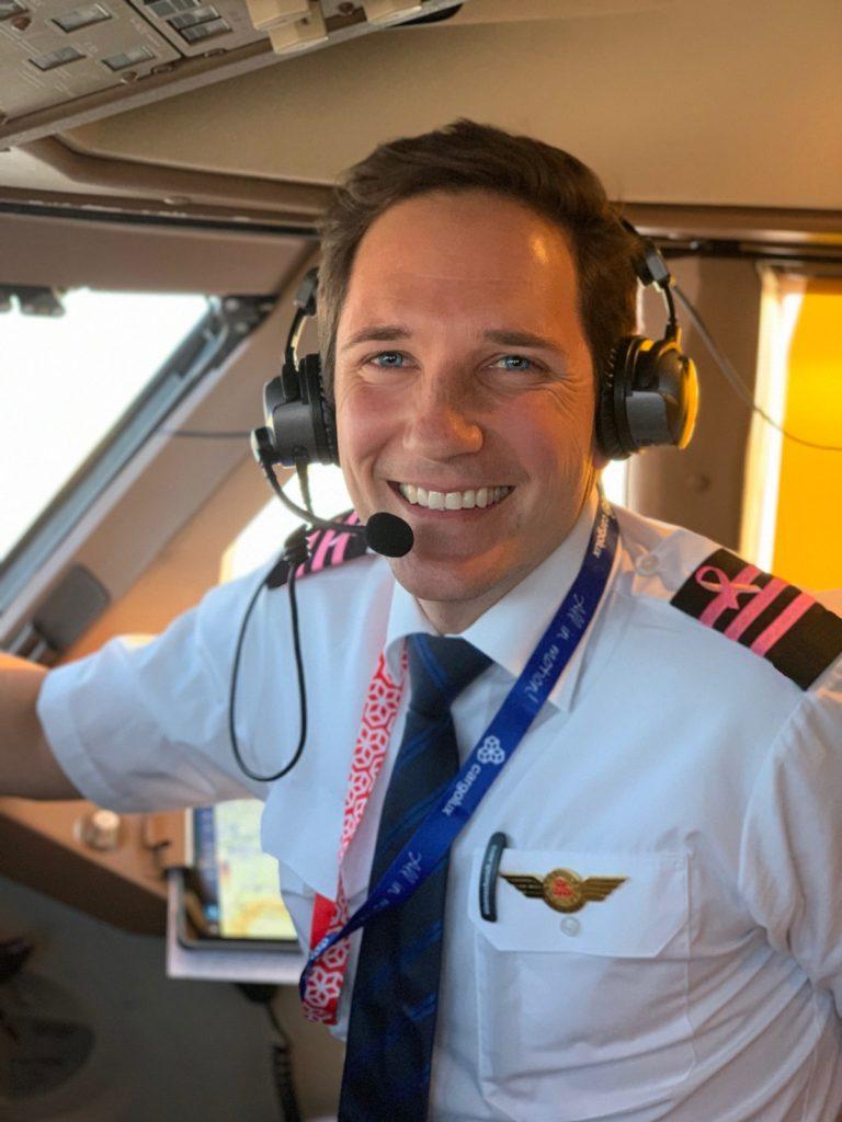 Captain Joe smiling in cockpit of plane